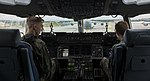 Two Civil Air Patrol cadets sit in the flight deck of a C-17A Globemaster III aircraft.jpg