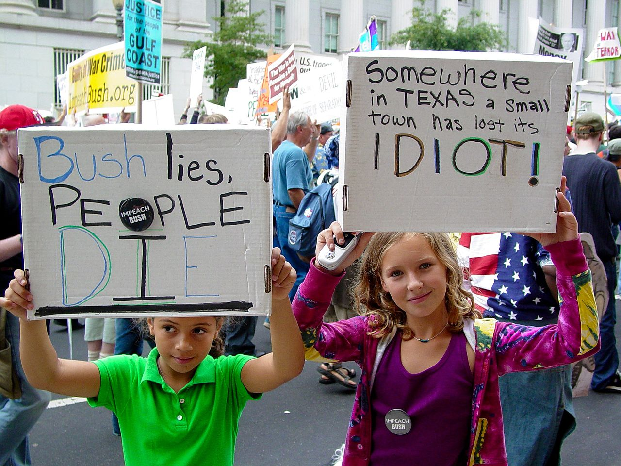 File Two Girls Hold Up Signs At The September 24 2005