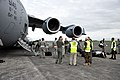 U.S. Airman, Royal New Zealand Air Force (RNZAF) airmen and U.S. Defense Attache Office personnel stand by as passengers begin unloading a U.S. Air Force C-17 Globemaster III aircraft Nov. 11, 2013, during 131111-F-FB147-082.jpg