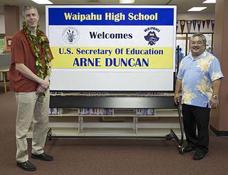 Waipahu High School - Arne Duncan (left) with principal Keith Hayashi in 2014