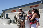 U.S. Marine Corps Maj. Jason Edholm, a future operations officer with the 3rd Marine Aircraft Wing, is greeted by his wife and children after returning from Afghanistan at Marine Corps Air Station Miramar 120902-M-XW721-002.jpg