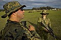 U.S. Marine Corps Sgt. Nick R. Hill, left, a III Marine Expeditionary Force combat shooting team member, jokes with Australian army Officer Cadet Corrine Seabrook before a shooting match during the 2012 120507-F-MQ656-290.jpg