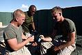 U.S. Marines with Combat Logistics Regiment 2, 2nd Marine Logistics Group, inspect ammunition for serviceability at an ammunition holding area during Enhanced Mojave Viper (EMV), on Marine Corps Air Ground 120912-M-KS710-014.jpg