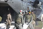 U.S. Sailors with Helicopter Mine Countermeasures Squadron (HM) 15, Detachment 2 help Pakistani soldiers load relief supplies onto a U.S. Navy MH-53E Sea Dragon helicopter during humanitarian relief efforts 100821-M-ZG155-480.jpg