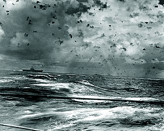 Imperial Japanese Navy in World War II - Anti-aircraft shell bursts, fired at attacking Japanese aircraft, fill the sky above USS Enterprise (center left) and her screening ships during the battle on 26 October 1942.