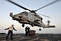 USS Jason Dunham conducts a vertical replenishment. (8559251459).jpg
