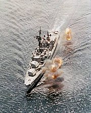 USS Lyman K. Swenson (DD-729) firing on shore targets in Vietnam, circa in 1969