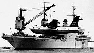 USS Pine Island (AV-12) with SP-5B Cam Ranh Bay 1965.jpg