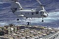 US Navy 030324-N-2143T-014 A CH-46 Sea Knight transfers ordnance aboard USNS Kilauea (T-AE 26) to the aircraft carrier USS Nimitz (CVN 68).jpg