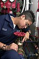 US Navy 030506-N-1577S-002 Fireman Erica Tello performs preventive maintenance and corrosion control on a valve, on an Aqueous Film Forming Foam (AFFF) station to prevent corrosion on the valves.jpg