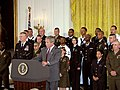 US Navy 030701-A-0000S-003 President Bush addresses an assembled audience during a White House ceremony commemorating the 30th anniversary of the all-volunteer force.jpg