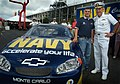 US Navy 030830-N-2383B-053 NASCAR Busch Series driver Casey Atwood and Adm. Vern Clark, Chief of Naval Operations (CNO), stand next to the Navy sponsored race car.jpg