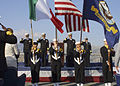 US Navy 031104-N-3168W-026 Guests and participants of the Commander Sixth Fleet and Striking and Support Forces South change of command salute as the colors are paraded.jpg