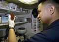 US Navy 040616-N-4565G-001 Advanced laboratory technician Hospital Corpsman 1st Class Ruben Layug examines the results of a strep culture.jpg