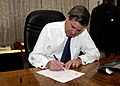 US Navy 040628-F-1351B-002 Ambassador L. Paul Bremer signs the Iraqi Sovereignty document.jpg