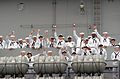 US Navy 040723-N-8252B-077 Sailors aboard USS Ronald Reagan (CVN 76) wave to loved ones during the ship's arrival at Naval Station North Island, San Diego, Calif.jpg