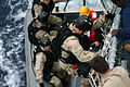 US Navy 040915-N-4158S-001 A Sailor from the Visit, Board, Search and Seizure (VBSS) team assigned to the guided missile destroyer USS Winston S. Churchill (DDG 81), climbs back aboard the ship during a mock boarding.jpg