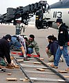 US Navy 050125-N-0685S-001 Crewmembers for the hit television show JAG set up for the next shot outside the Transient Aircraft Line on board Naval Air Station North Island, Calif.jpg