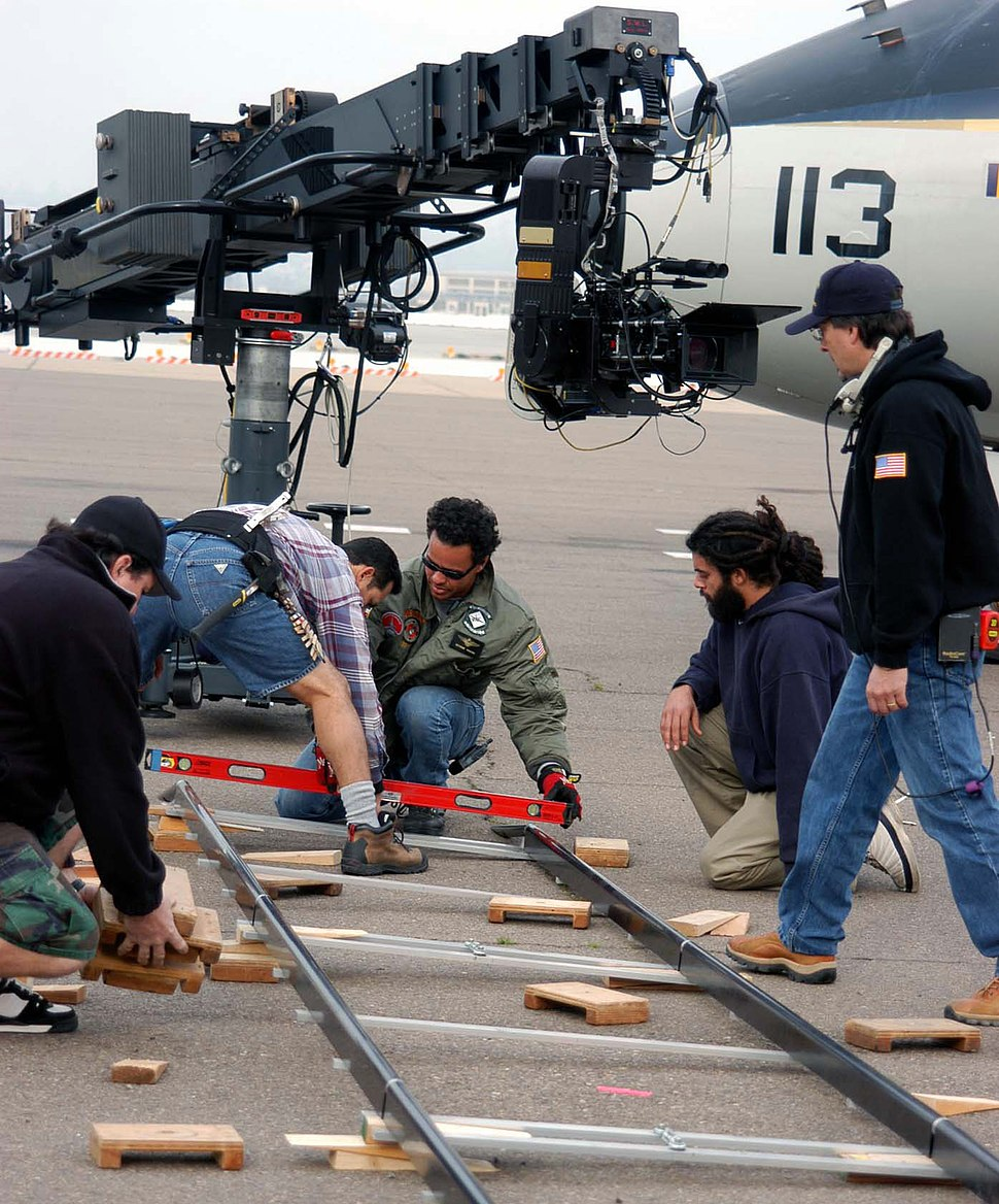 US Navy 050125-N-0685S-001 Crewmembers for the hit television show JAG set up for the next shot outside the Transient Aircraft Line on board Naval Air Station North Island, Calif