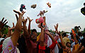 US Navy 050214-N-0357S-071 A group of Indonesians living in a camp for internally displaced persons in Banda Aceh on the island of Sumatra, Indonesia, reach for stuffed animals thrown to them by Sailors.jpg