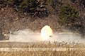 US Navy 050319-F-9629D-114 U.S. Army Soldiers, assigned to the 1st Squadron, 1st Calvary Regiment, fire the cannon from a M1A1 Abrams main battle tank during a live fire exercise at Rodriguez Live Fire Complex, Republic of Kore.jpg