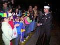 US Navy 060225-N-8374E-003 Seaman Recruit Zachary D. Lyons, assigned to the amphibious transport dock ship USS Trenton (LPD 14) gives beads to cheering spectators along the Krewe of Momus Mardi Gras parade route.jpg