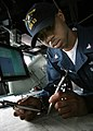 US Navy 060504-N-4953E-030 Quartermaster 3rd Class Carrin Johnson assigned to the guided-missile destroyer USS Stethem (DDG 63), plots the ship's course.jpg