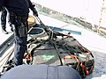 US Navy 080913-N-0000F-090 In this photo released by the U.S. Coast Guard, a member of Coast Guard law enforcement detachment 404 prepares some of the 37 bales of cocaine seized from a self-propelled, semi-submersible craft.jpg