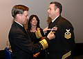 US Navy 090107-N-7948R-065 Vice Adm. Mark E. Ferguson, III presents the Navy-Marine Corps Commendation Medal to Chief Explosive Ordnance Disposal Kevin Parra.jpg