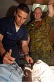 US Navy 090416-F-7751S-067 Canadian Army Lt. Trevor Gill watches as Hospital Corpsman Niko Lunetta treats a patient aboard the Military Sealift Command hospital ship USNS Comfort (T-AH 20).jpg