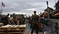 US Navy 090712-A-7779L-046 U.S Marines assigned to the 2nd Marine Expeditionary Force (2nd MEF) and Brazilian Marines offload boxes of Measl Ready To Eat off Landing Craft Unit (LCU) 1643 on Governor's Island in Rio De Janeiro.jpg