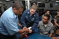 US Navy 090721-A-8397T-003 Hospital Corpsman 1st Class Elizabeth Gracie demonstrates how to apply a splint on a broken arm to Brazilian Navy sailors aboard the amphibious dock landing ship USS Oak Hill (LSD 51).jpg