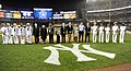 US Navy 090911-N-0413R-155 Sailors assigned to the amphibious transport dock ship Pre-Commisioning Unit (PCU) New York (LPD 21) and members of the commissioning committee are introduced during a pre-game ceremony at Yankee Stad.jpg