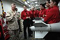 US Navy 090913-N-9818V-309 Master Chief Petty Officer of the Navy (MCPON) Rick West speaks with Sailors from the weapons department aboard the aircraft carrier USS Ronald Reagan (CVN 76).jpg