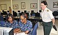 US Navy 090925-N-8848T-875 Lt. Col. Martine Dierckx, from the Belgian Armed Forces, looks over the shoulders of Fireman Brittany Trotter and Fireman Whitney Adams, both from Atlanta, in the Center for Naval Engineering Learning.jpg