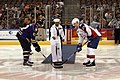 US Navy 091009-N-1928H-125 Serviceman 1st Class Cedric Avant, Sailor of the Quarter aboard the guided-missile destroyer USS Nitze (DDG 94), drops the first puck at a Norfolk Admirals hockey game.jpg