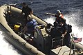 US Navy 091117-N-9500T-206 A boat crew from USS Chosin (CG 65) launches a rigid hull inflatable boat to rescue three men.jpg
