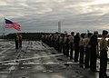 US Navy 100118-N-7918H-001 Sailors and Marines man the rails aboard the amphibious dock landing ship USS Ashland (LSD 48) as the ship departs Joint Expeditionary Base Little Creek-Fort Story.jpg