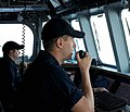 US Navy 100402-N-7653W-060 Lt. j.g. Justin Guernsey communicates on the ship's VHF radio while standing watch on the bridge of the littoral combat ship USS Independence (LCS 2).jpg