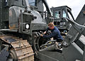 US Navy 100908-N-3089C-001 Sailor prepares a dozer for deployment.jpg