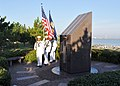 US Navy 101012-N-5292M-832 Members of a Navy honor guard from the guided-missile destroyer USS Cole (DDG 67) practice rendering colors before a mem.jpg