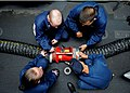 US Navy 101026-N-2908M-006 Sailors aboard the amphibious assault ship USS Kearsage (LHD 3) conduct damage control training on a ventilation fan dur.jpg
