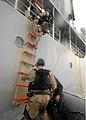 US Navy 110121-N-5339K-025 Members of the visit, board, search and seizure (VBSS) team assigned to the guided-missile destroyer USS Mitscher (DDG 5.jpg