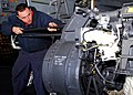 US Navy 110218-N-KF029-035 Aviation Ordnanceman 2nd Class Andrew Marton, from Reno, Nev., conducts maintenance on an M61A2 gun system in the hangar.jpg