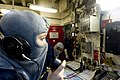 US Navy 110219-N-2953W-138 Hull Maintenance Technician Fireman Apprentice Amanda Mathis uses a sound-powered telephone to communicate with Damage C.jpg