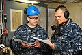 US Navy 110324-N-VF447-001 Machinist Mate 2nd Class Jaun P. Cardona, left, and Machinist Mate 1st Class Raul Ayalasagun communicate through sound-p.jpg