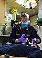 US Navy 110609-N-VL218-014 Lt. Christine Baker, a dentist assigned to the amphibious transport dock ship USS San Antonio (LPD 17), injects a local.jpg