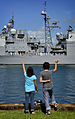 US Navy 110624-N-RI884-066 Family members of Sailors assigned to the Ticonderoga-class guided-missile cruiser USS Port Royal (CG 73) wave as the sh.jpg