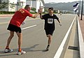 US Navy 110815-N-XG305-723 Col. Michael Palermo cheers for Hung Yeung during a 5-kilometer friendship run.jpg