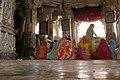 Udaipur, India, Women in colorful saris in Hindu temple.jpg